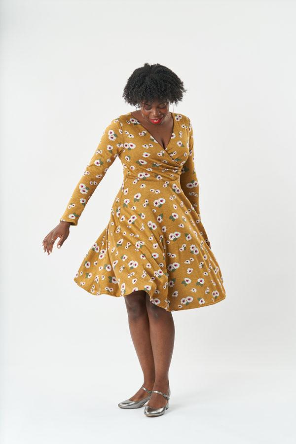 Salma in a wrap style dress twirling