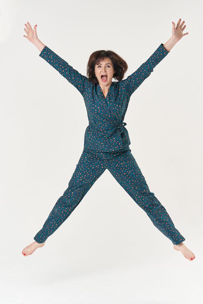 Lisa jumping in the air, pleased to be wearing her animal=print Luna Pyjamas!