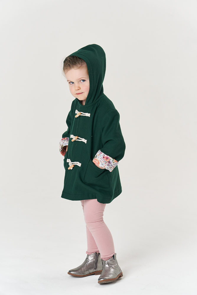 Jasmine wearing the Poppy & Jazz Walnut Duffle Coat, posing with her hood up and hands in her pockets