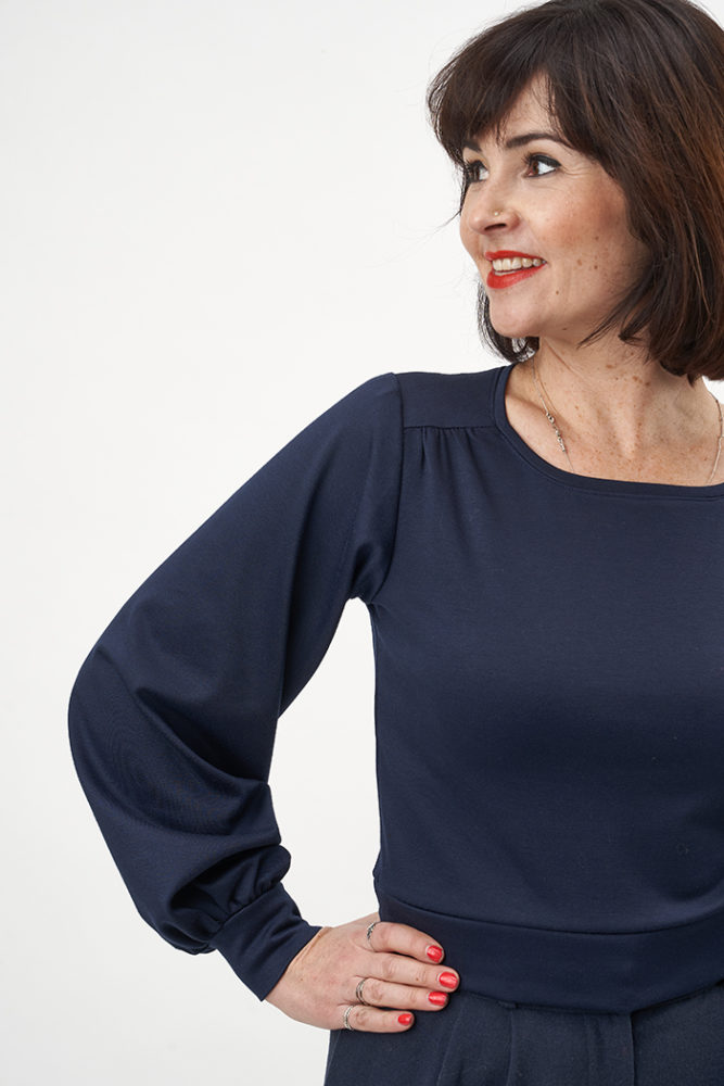 Close-up image of Lisa wearing a navy Roxy Jumper and smiling