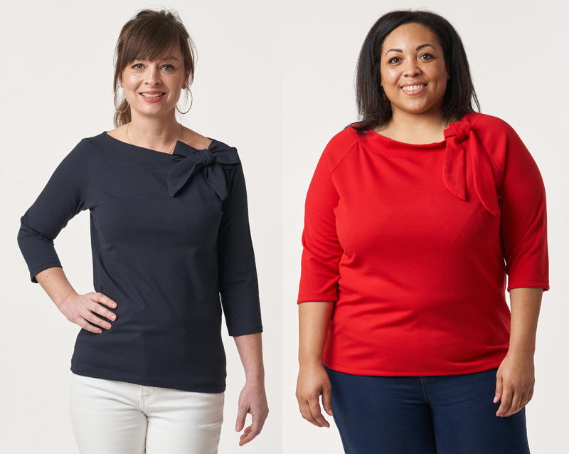 Left to right: Anna wearing a charcoal Audrey Top and standing with one hand on her hip; Chantelle wearing a striking red Audrey Top and standing with her hands down by her sides.